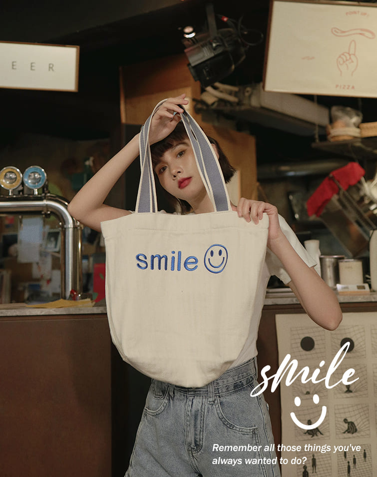 EMBROIDERED SMILE CANVAS BAG